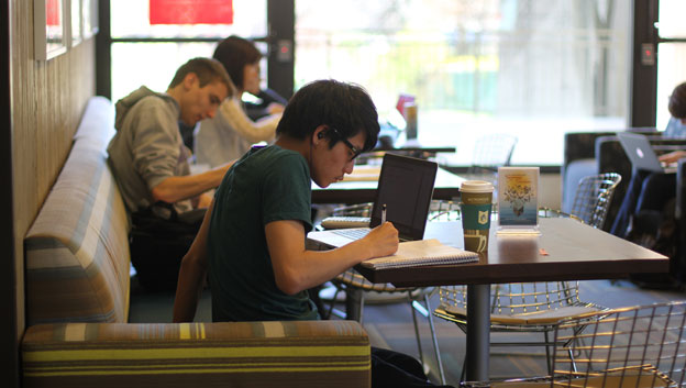 Student working in Library cafe